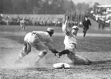 Ty Cobb spikes Frank Baker at third base