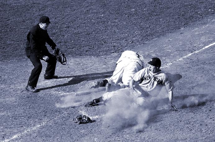 Joe DiMaggio slides past a dazed Ernie Lombardi in the 1939 World Series