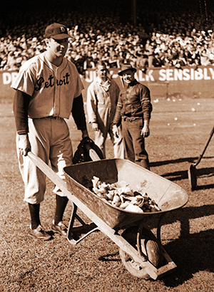 Hank Greenberg helping to haul trash off of Cleveland's field in 1940