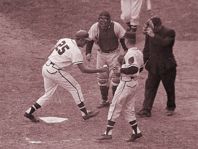 Nippy Jones shows umpire shoe-polished ball in 1957 World Series