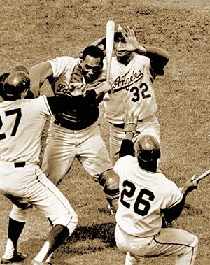 The Giants' Juan Marichal swings his bat at Dodgers catcher Johnny Roseboro