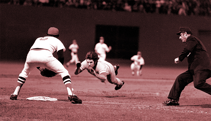 Pete Roses slides head first into third base during 1975 World Series