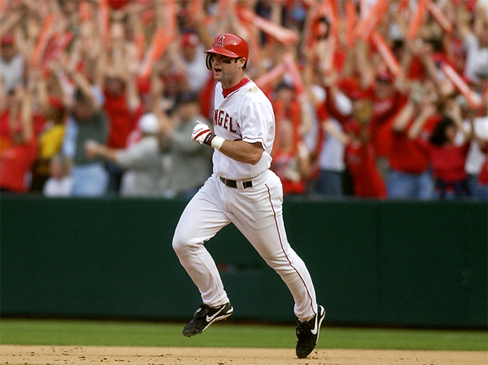 The Angels' Adam Kennedy rounds the bases after hitting on of his three home runs in an ALCS victory over Minnesota