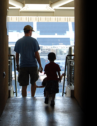 Father and two kids entering ballpark