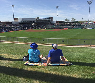Spring training fans relaxed on outfield grass berm