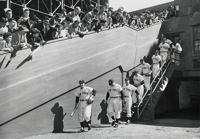Yankees players coming down stairs at the Polo Grounds